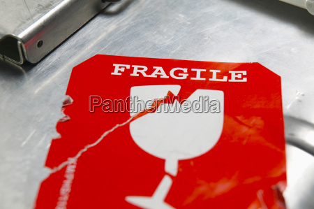 adhesive label on suitcase close up