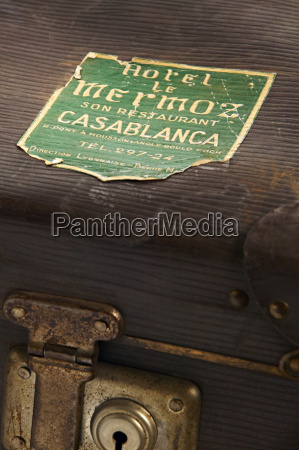 old suitcase with travel stickers
