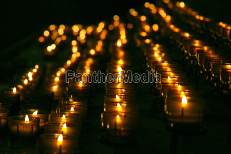 burning candles in church close up
