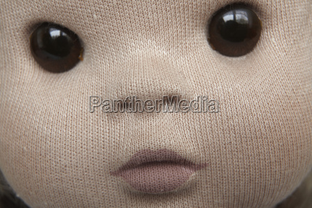 close up of doll face made