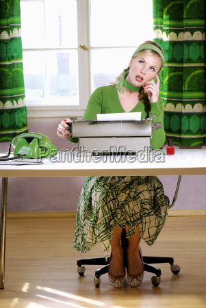young woman sitting at desk