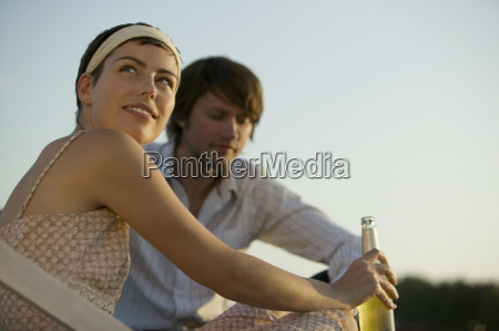 young couple smiling low angle view