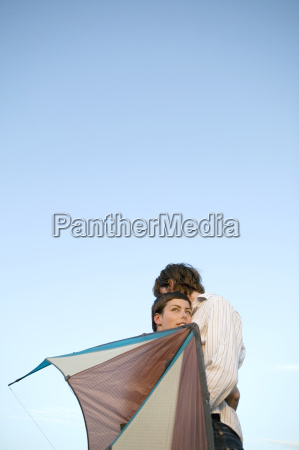 young couple embracing low angle view