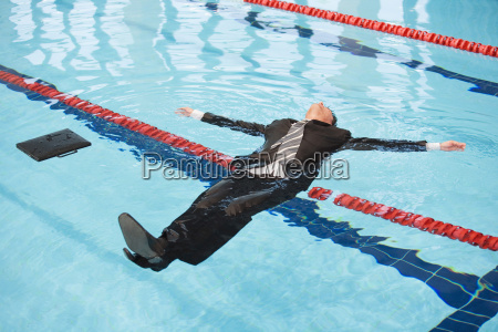 businessman drifting in water