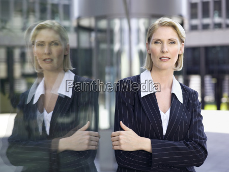 germany baden wuerttemberg stuttgart businesswoman arms