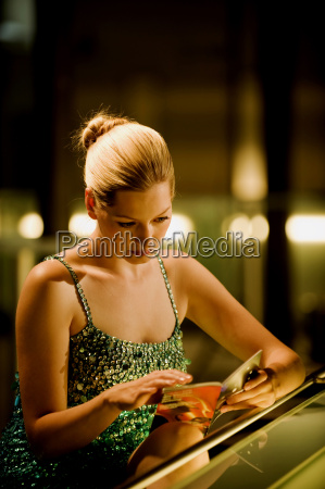 young woman in bar looking at