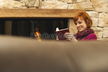 woman in front of fire place