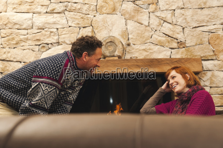 couple in living room at fireplace