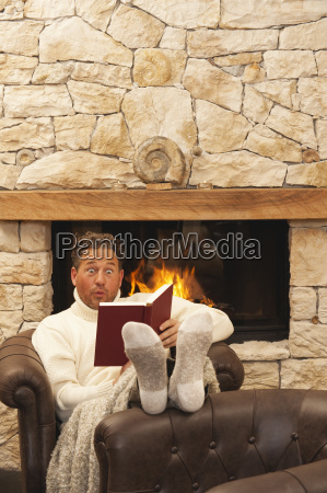 man in front of fire place