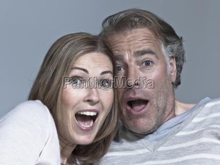 couple looking surprised portrait