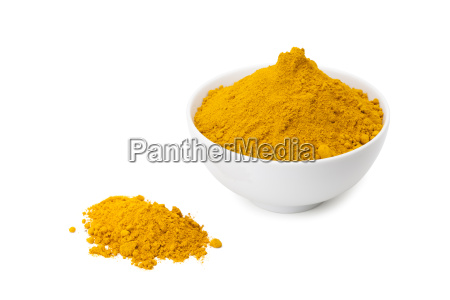 turmeric powder in white ceramic bowl