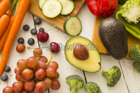 avocado and red grapes surrounded by