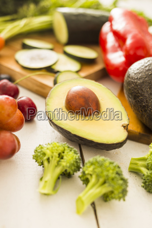 avocado surrounded by various fruits and