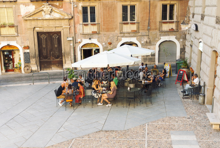people eating at outdoor cafe in