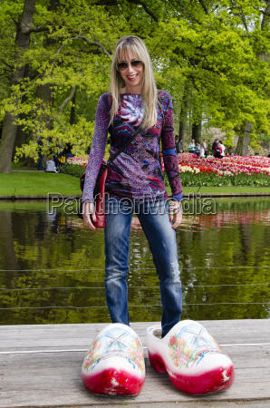 woman with giant clogs at park