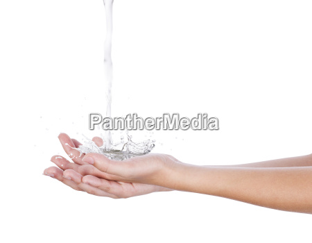 water falls on the palm of