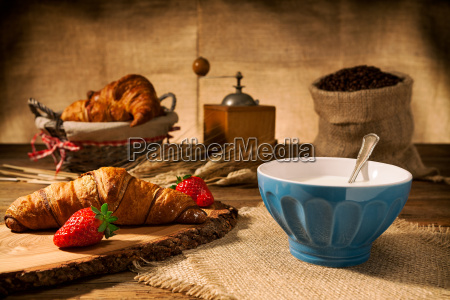 continental breakfast with croissant and milk