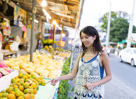 woman shopping in hawker at street