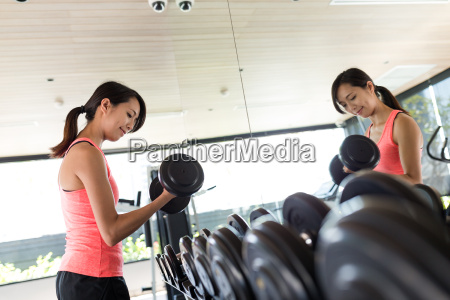 woman exercising with weights in the