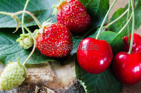 fresh ripe organic strawberry and cherries