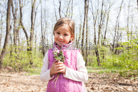 spring portrait of happy little girl