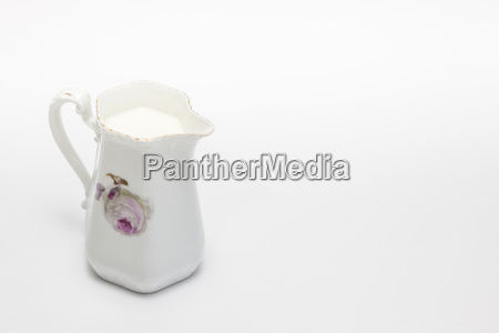 old grandmas pitcher full of milk