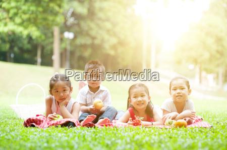 happy asian children picnics outdoor