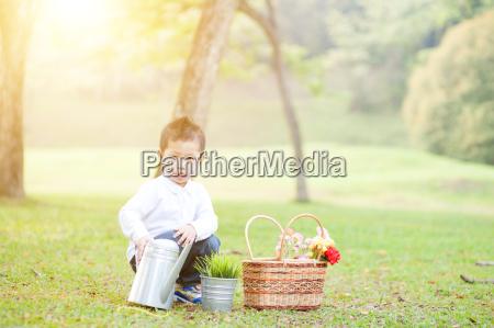 asian boy picnic outdoors