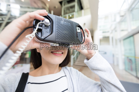 woman try on virtual reality in