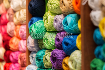shelves with colorful wool and yarn