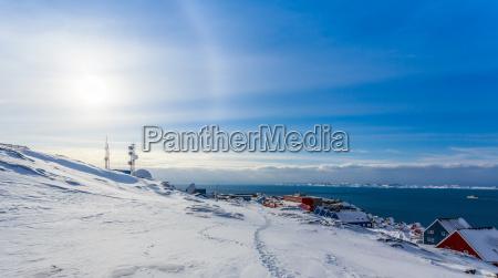 arctic sun halo shining over houses