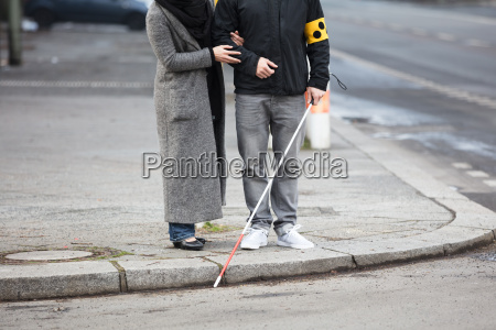 woman with a blind man on