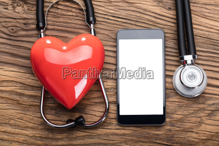 heart over the stethoscope around the