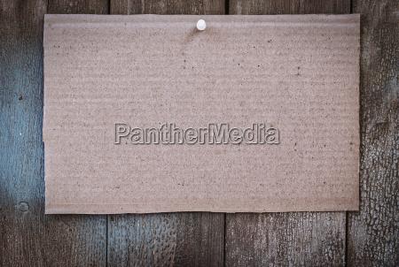 piece of brown kraft paper hanging