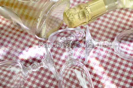 white wine bottle and flute