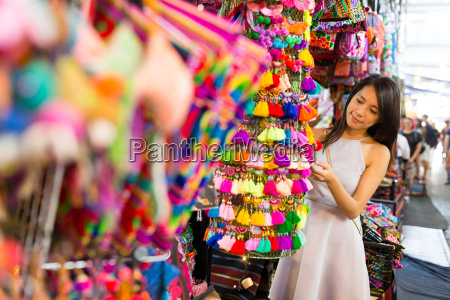 woman buying in street market