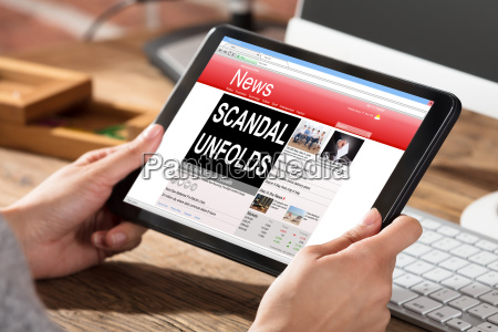 woman reading scandal news on digital