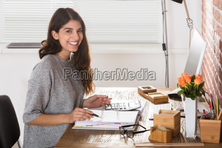 happy businesswoman at workplace