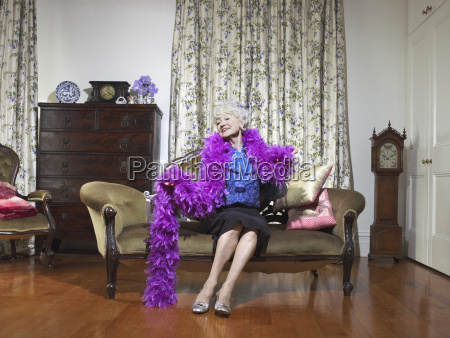senior woman wearing feather boa in