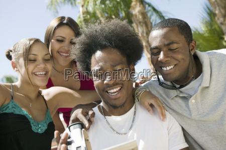 four friends in back yard looking