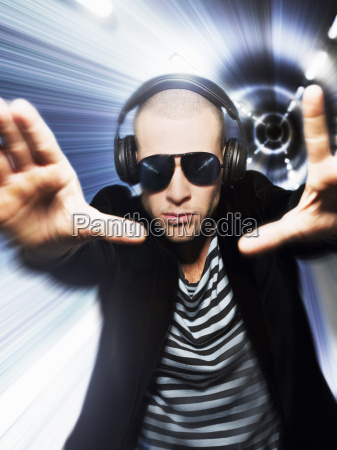 man wearing headphones and sunglasses with