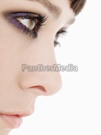 young woman wearing heavy eye makeup