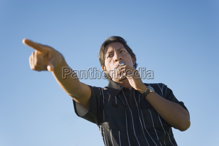 soccer referee whistling