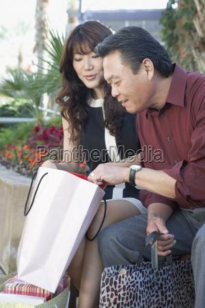 shopaholic couple checking bags