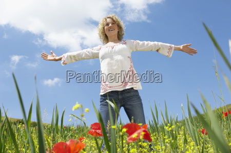 woman with arms outstretched standing in