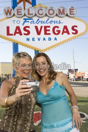 female friends taking self portrait with