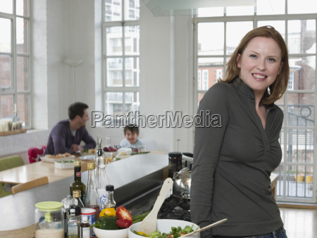 woman standing at kitchen counter with
