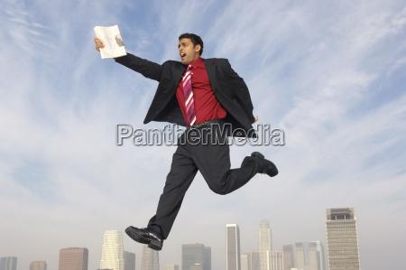 businessman running in midair