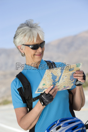 senior woman reading map
