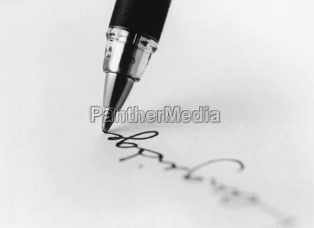 tip of pen writing on paper